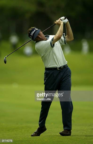 Greg Hanrahan of the USA plays his second shot into the 15th green during the third round of the 2004 Caltex Singapore Masters played at Laguna...