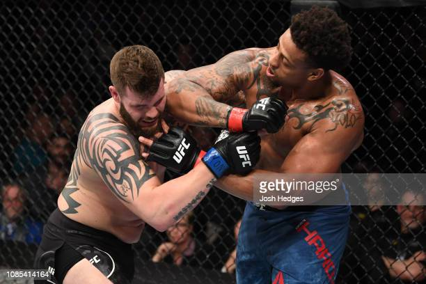 Greg Hardy elbows Allen Crowder in their heavyweight bout during the UFC Fight Night event at the Barclays Center on January 19 2019 in the Brooklyn...