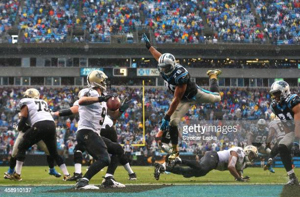Greg Hardy of the Carolina Panthers goes after Drew Brees of the New Orleans Saints during their game at Bank against the Carolina Panthers of...