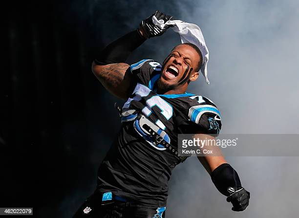 Greg Hardy of the Carolina Panthers runs onto the field during player introductions against the San Francisco 49ers during the NFC Divisional Playoff...