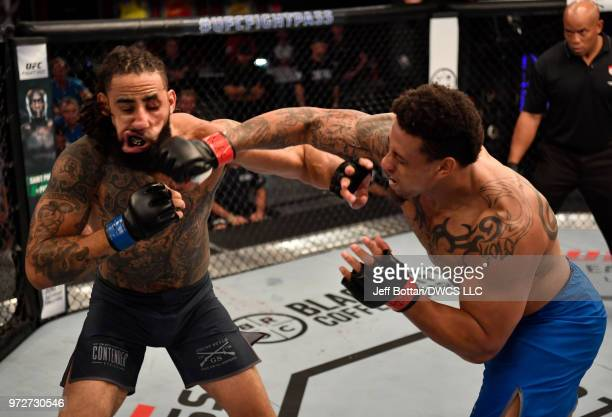 Greg Hardy punches Austen Lane in their heavyweight bout during Dana White's Tuesday Night Contender Series at the TUF Gym on June 12 2018 in Las...