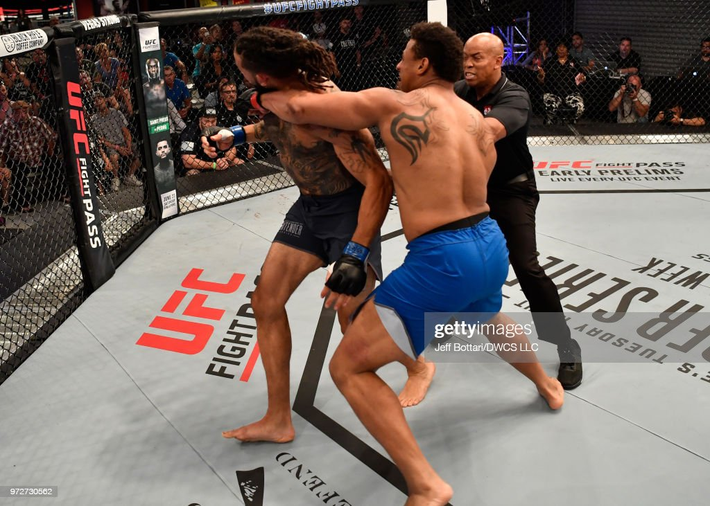 Greg Hardy punches Austen Lane in their heavyweight bout during Dana White's Tuesday Night Contender Series at the TUF Gym on June 12, 2018 in Las Vegas, Nevada.