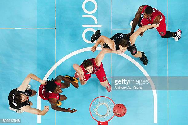 Greg Hire and Jameel McKay of the Wildcats compete for position against Kirk Penney of the Breakers during the round 11 NBL match between New Zealand...