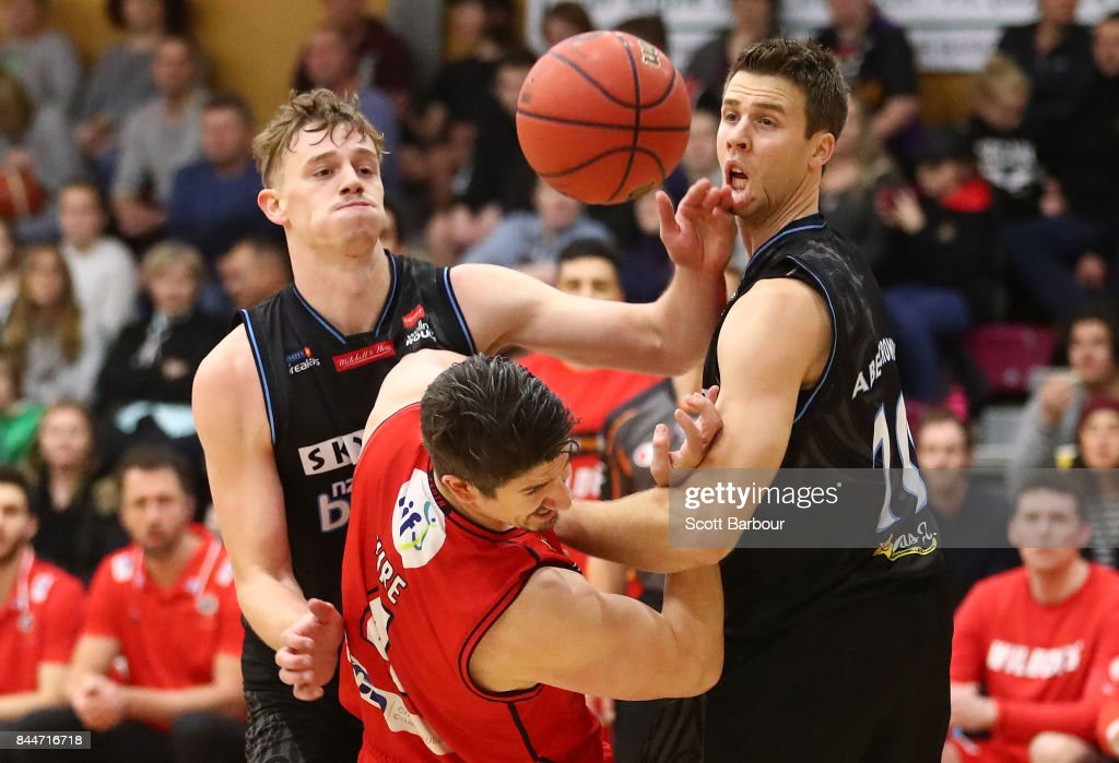 Greg Hire of the Perth Wildcats and Finn Delany and Thomas Abercrombie of the New Zealand Breakers compete for the ball during the 2017 NBL Blitz pre-season match between the Perth Wildcats and the New Zealand Breakers at Traralgon Basketball Centre on September 9, 2017 in Traralgon, Australia.