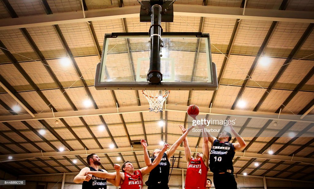 Greg Hire of the Perth Wildcats and Thomas Abercrombie of the New Zealand Breakers compete for the ball during the 2017 NBL Blitz pre-season match between the Perth Wildcats and the New Zealand Breakers at Traralgon Basketball Centre on September 9, 2017 in Traralgon, Australia.