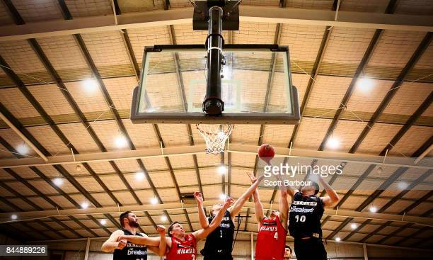 Greg Hire of the Perth Wildcats and Thomas Abercrombie of the New Zealand Breakers compete for the ball during the 2017 NBL Blitz preseason match...