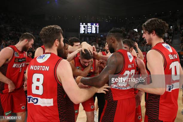 Greg Hire of the Wildcats celebrates with team mates after winning the championship during game 4 of the NBL Grand Final Series between Melbourne...