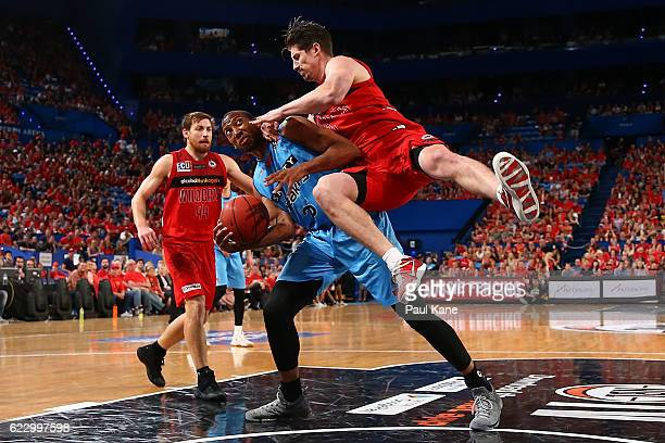 Greg Hire of the Wildcats crashes into Akil Mitchell of the Breakers during the round six NBL match between the Perth Wildcats and the New Zealand...