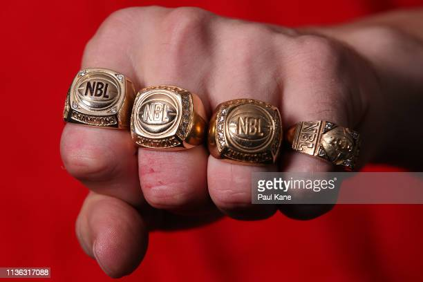 Greg Hire of the Wildcats poses with his NBL championship rings after winning the grand final series during game 4 of the NBL Grand Final Series...