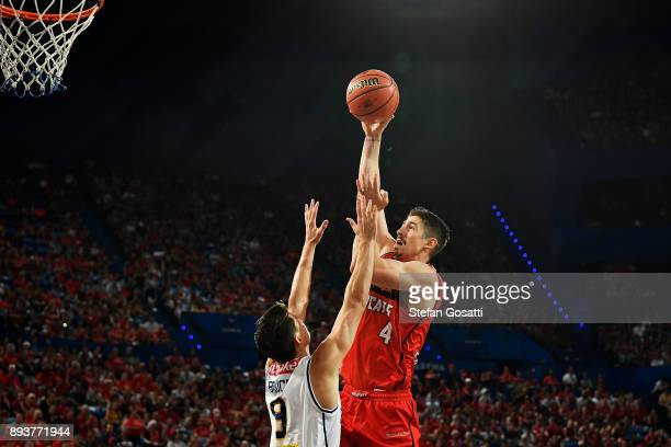 Greg Hire of the Wildcats puts a shot up against Shaun Bruce of the Bullets during the round 10 NBL match between the Perth Wildcats and the Brisbane...