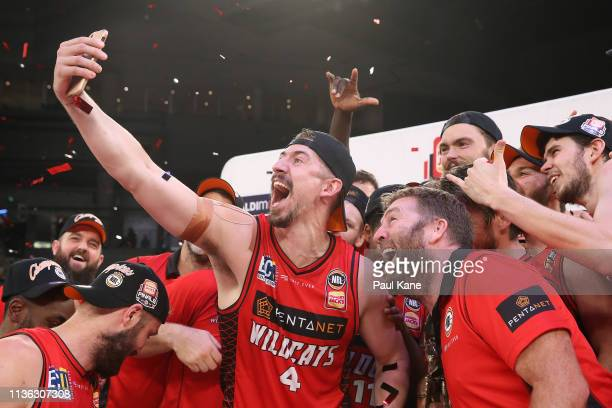 Greg Hire of the Wildcats takes a selfie with the team after winning the NBL championship during game 4 of the NBL Grand Final Series between...
