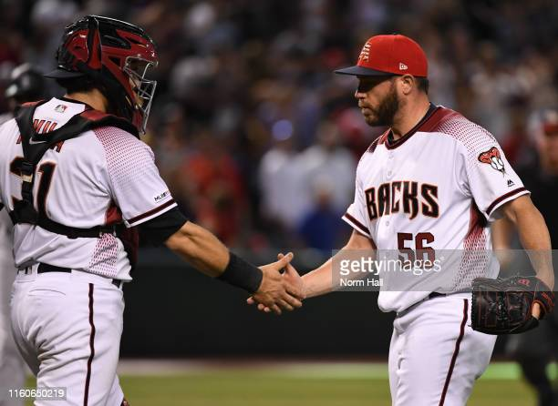 Greg Holland and Alex Avila of the Arizona Diamondbacks celebrate a 5-3 victory against the Colorado Rockies at Chase Field on July 07, 2019 in...
