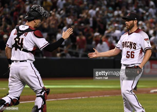 Greg Holland and Caleb Joseph of the Arizona Diamondbacks celebrate a 3-2 win against the New York Yankees at Chase Field on May 01, 2019 in Phoenix,...