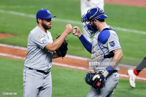 Greg Holland and Cam Gallagher of the Kansas City Royals celebrate a 3-0 victory over the Cleveland Indians at Progressive Field on September 09,...