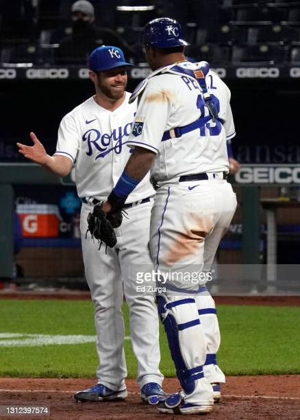 Greg Holland and Salvador Perez of the Kansas City Royals celebrate a 3-2 win over the Los Angeles Angels at Kauffman Stadium on April 13, 2021 in...