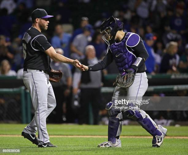 Greg Holland and Tony Wolters of the Colorado Rockies celebrate a win over the Chicago Cubs against the Chicago Cubs at Wrigley Field on June 8 2017...