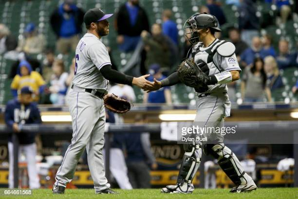 Greg Holland and Tony Wolters of the Colorado Rockies celebrate after beating the Milwaukee Brewers 65 at Miller Park on April 4 2017 in Milwaukee...