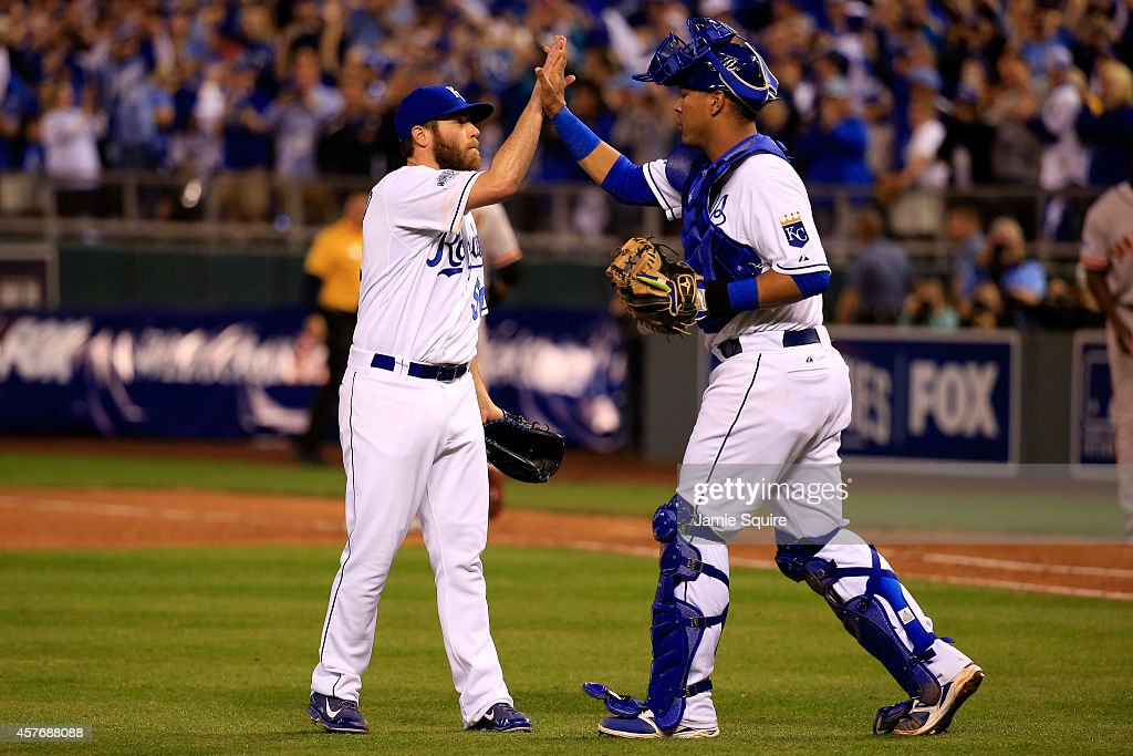 Greg Holland #56 celebrates with Salvador Perez #13 of the Kansas City Royals after defeating the San Francisco Giants 7-2 in Game Two of the 2014 World Series at Kauffman Stadium on October 22, 2014 in Kansas City, Missouri.