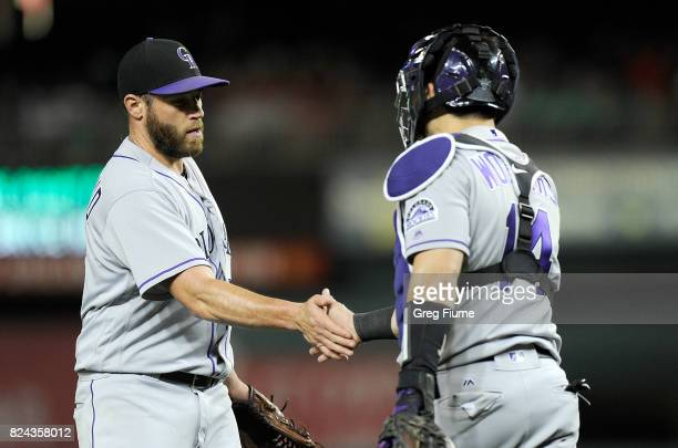 Greg Holland of the Colorado Rockies celebrates with Tony Wolters after a 42 victory against the Washington Nationals at Nationals Park on July 29...
