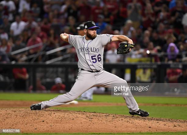 Greg Holland of the Colorado Rockies delivers a pitch against the Arizona Diamondbacks during the National League Wild Card Game at Chase Field on...