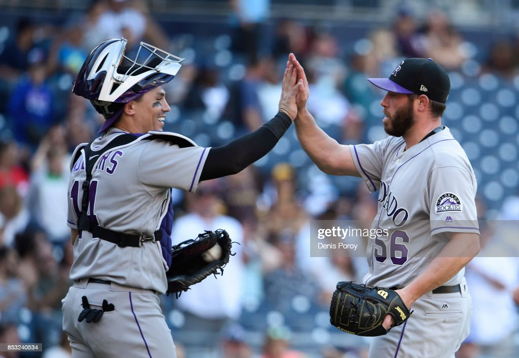 Greg Holland #56 of the Colorado Rockies is congratulated by Tony Wolters #14 after getting the final out during the ninth inning of a baseball game against the San Diego Padres at PETCO Park on September 24, 2017 in San Diego, California. The Rockies won 8-4.