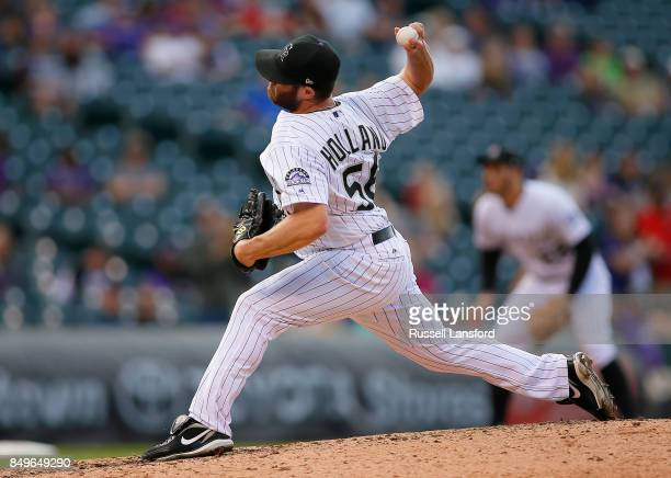 Greg Holland of the Colorado Rockies pitches during a regular season MLB game between the Colorado Rockies and the visiting San Diego Padres at Coors...