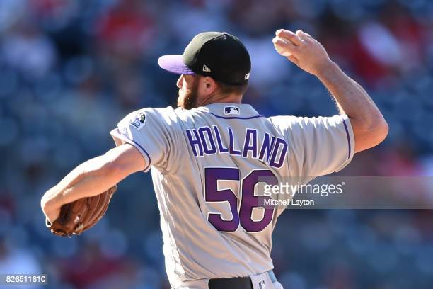 Greg Holland of the Colorado Rockies pitches during game one of a doubleheader baseball game against the Washington Nationals at Nationals Park on...