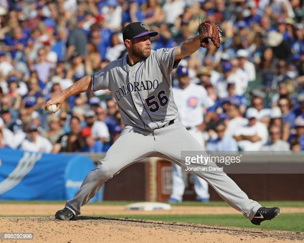 Greg Holland of the Colorado Rockies pitches in the 9th inning against the Chicago Cubs at Wrigley Field on June 9 2017 in Chicago Illinois The...