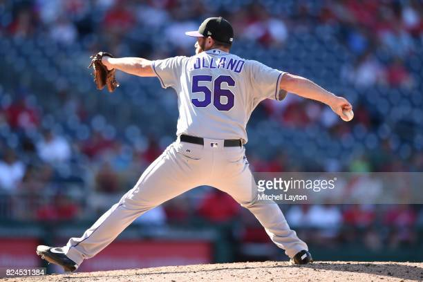 Greg Holland of the Colorado Rockies pitches in the ninth inning during game one of a doubleheader baseball game against the Washington Nationals at...