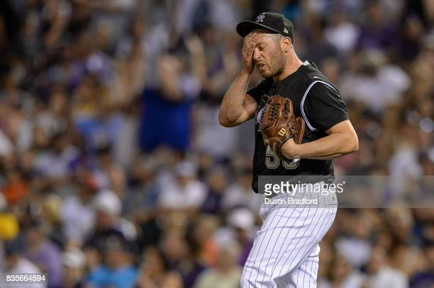 Greg Holland of the Colorado Rockies reacts after allowing a goahead two run homerun in the ninth inning of a game against the Milwaukee Brewers at...