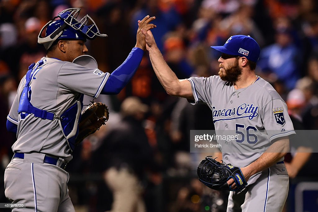 Greg Holland #56 of the Kansas City Royals celebrates with teammate Salvador Perez #13 after closing out the ninth inning to defeat the Baltimore Orioles 6 to 4 in Game Two of the American League Championship Series at Oriole Park at Camden Yards on October 11, 2014 in Baltimore, Maryland.