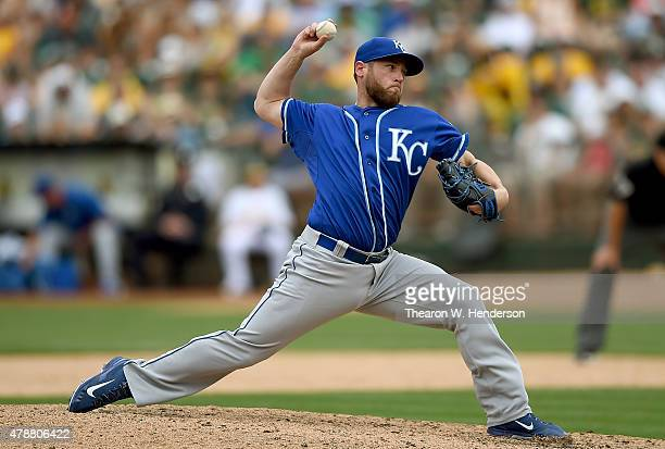 Greg Holland of the Kansas City Royals pitches against the Oakland Athletics in the ninth inning at Oco Coliseum on June 27 2015 in Oakland...