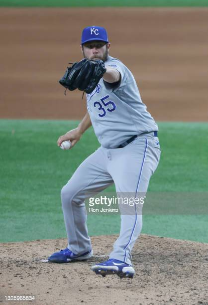 Greg Holland of the Kansas City Royals pitches against the Texas Rangers during the eighth inning at Globe Life Field on June 27, 2021 in Arlington,...