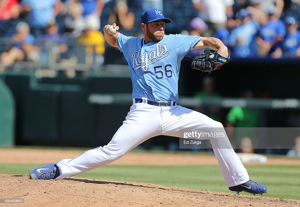 Greg Holland #56 of the Kansas City Royals throws in the ninth inning against the Cleveland Indians at Kauffman Stadium on June 11, 2014 in Kansas City, Missouri.