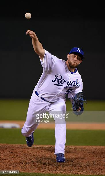 Greg Holland of the Kansas City Royals warms up as he prepares to throw agains the Boston Red Sox in the ninth inning at Kauffman Stadium on June 20,...