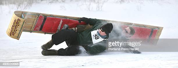 Greg Holt left of Camden and Chuck Christie of Rockport members of team Throbbin Boggins perform a roll at the end of their 2person qualifying run...