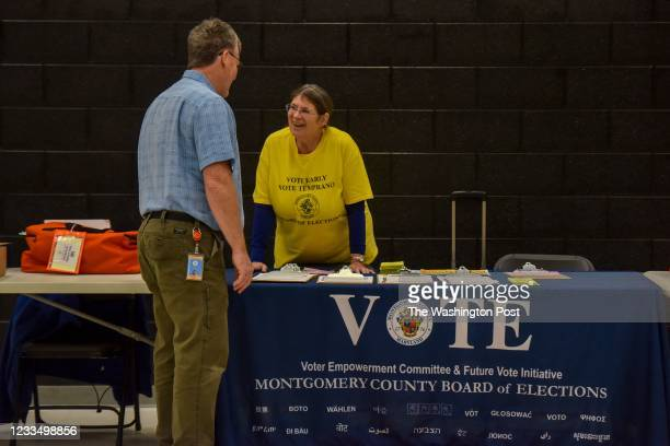 Greg Humes, L, and Nina Uzick, two veteran local election judges with Montgomery County Board of Elections, prepare for the upcoming midterms...