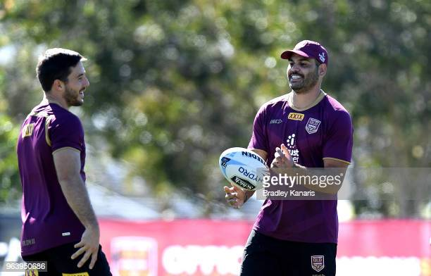 Greg Inglis and Ben Hunt share a laugh during a Queensland Maroons training session at Sanctuary Cove on May 31 2018 at the Gold Coast Australia