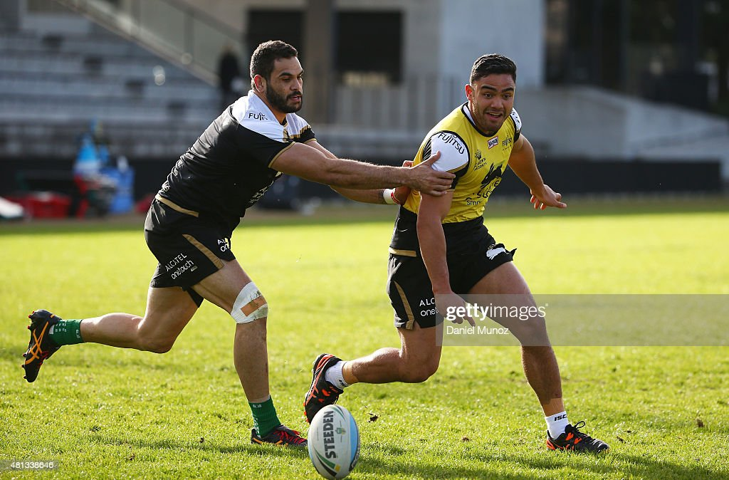 Greg Inglis and Dylan Walker fight for the ball during a South Sydney Rabbitohs NRL training session at Redfern Olval on July 20, 2015 in Sydney, Australia.