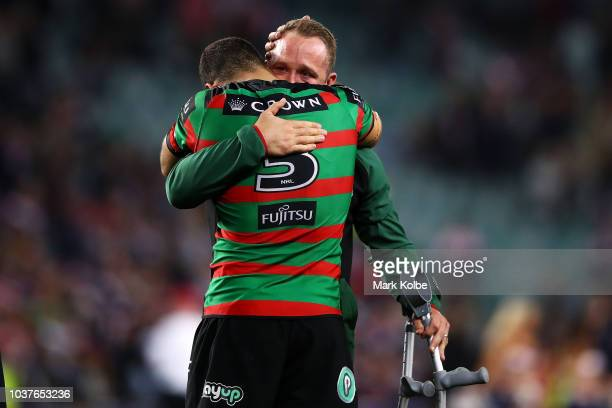 Greg Inglis and Jason Clark of the Rabbitohs embraces after defeat during the NRL Preliminary Final match between the Sydney Roosters and the South...