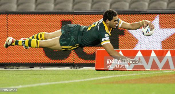 Greg Inglis dives over to score Australia's second try against England in their Rugby League World Cup match at the Docklands Stadium in Melbourne on...