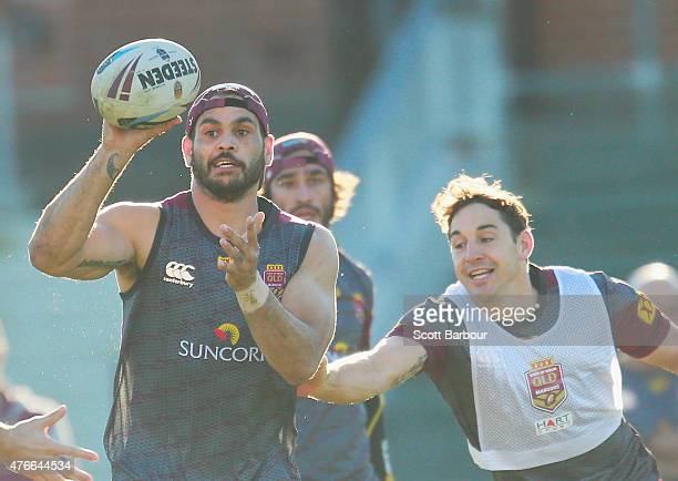 Greg Inglis is tackled by Billy Slater during a Queensland Maroons State of Origin team training session at Punt Road Oval on June 11 2015 in...