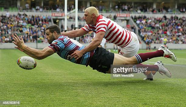 Greg Inglis of Australia and Ryan Hall of England contest the ball in goal during the Four Nations match between the Australian Kangaroos and England...