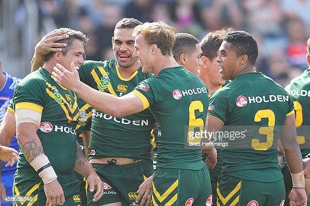 Greg Inglis of Australia celebrates scoring a try with team mates during the Four Nations match between the Australian Kangaroos and Samoa at WIN...