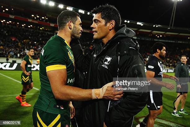 Greg Inglis of Australia congratulates head coach Stephen Kearney of New Zealand after the Four Nations Final between the New Zealand Kiwis and the...