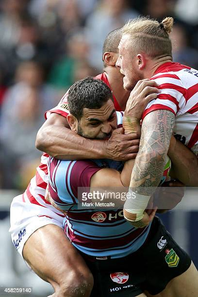 Greg Inglis of Australia is tackled during the Four Nations match between the Australian Kangaroos and England at AAMI Park on November 2 2014 in...