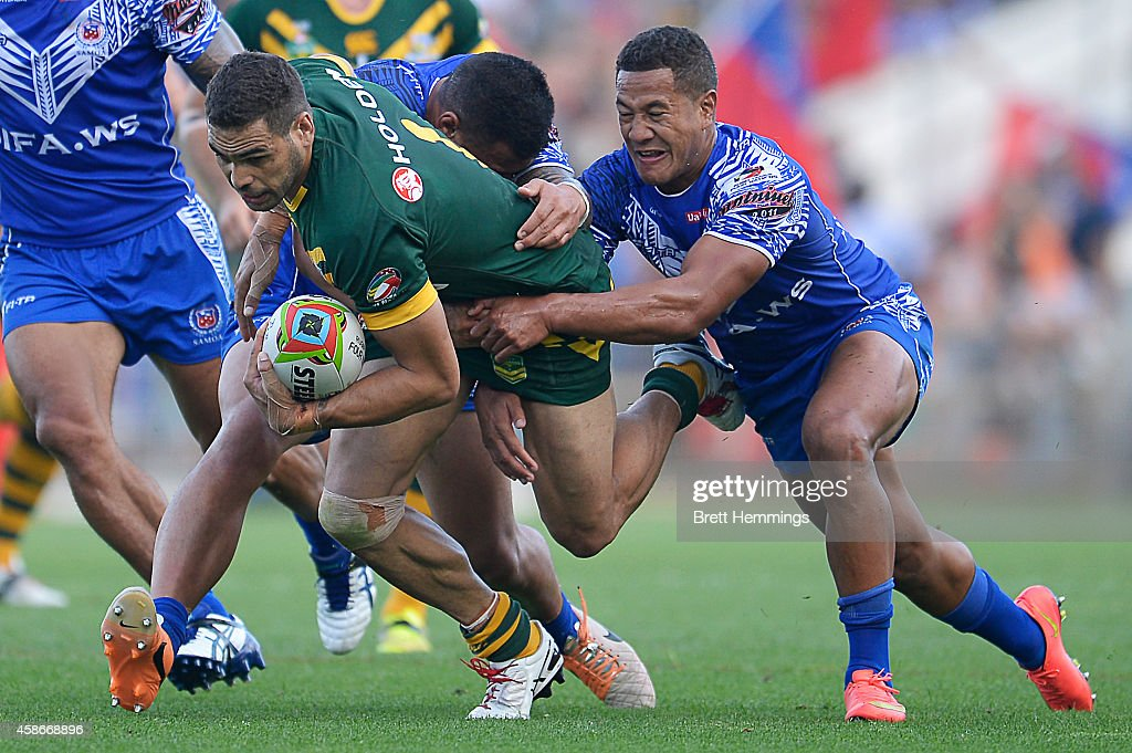 Greg Inglis of Australia is tackled during the Four Nations match between the Australian Kangaroos and Samoa at WIN Stadium on November 9, 2014 in Wollongong, Australia.