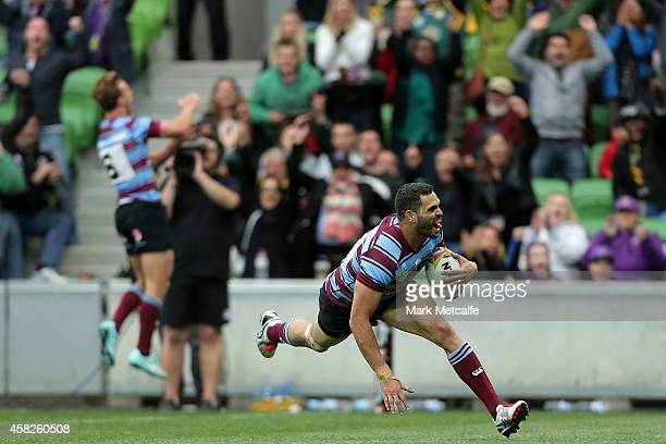 Greg Inglis of Australia scores a try during the Four Nations match between the Australian Kangaroos and England at AAMI Park on November 2 2014 in...