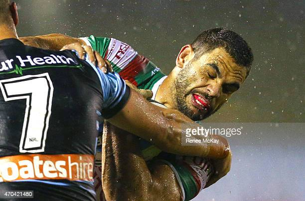 Greg Inglis of Souths is tackled by Jeff Robson of the Sharks during the round seven NRL match between the Cronulla Sharks and the South Sydney...