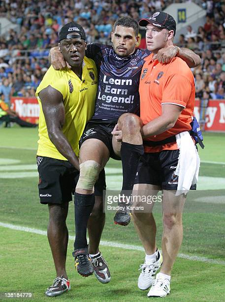Greg Inglis of the Indigenous All Stars is carried from the field with an injured ankle during the match between the Indigenous All Stars and the NRL...